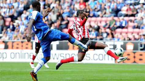 Ghana striker Asamoah Gyan scored both goals for Sunderland to beat Stoke 2-0 in his full English Premier League debut on Saturday.