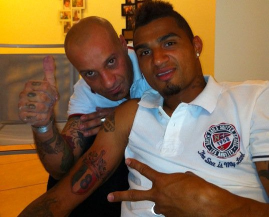 Kevin Prince Boateng shows off his tattoo for AC Milan's 18th league