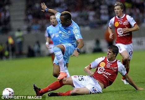 Ghana striker Jordan Ayew could end up as good as Lyon forward Bafetimbi Gomis, whose treble sank Marseille in midweek, OM coach Elie Baup has said.