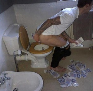 In what will enrage hard-working football fans all over the world, West Brom defender Liam Ridgewell has been pictured wiping his backside with money.