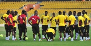Ghana team in a mini-meeting before Tuesday's training session