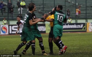 Video: Indonesian player banned for life after punching referee in the face