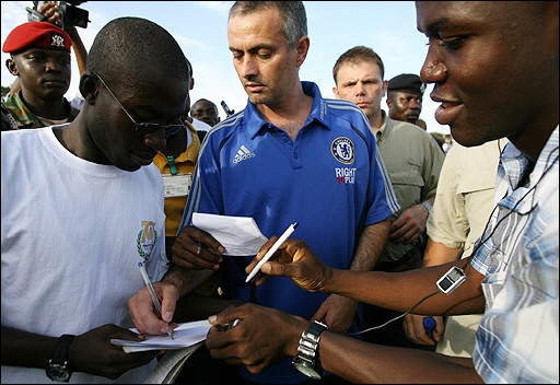 Mourinho signing autographs on his first visit to Ghana