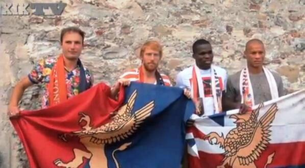 Isaac Cofie (second right) was unveiled by Genoa on Thursday.