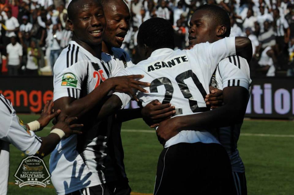 Asante with team-mates celebrating after scoring opener
