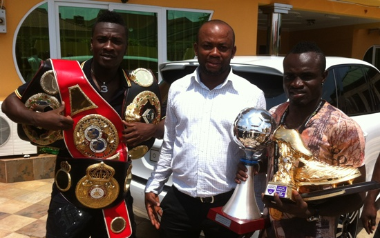 From left - Asamoah Gyan, Samuel Anim Addo (Chief Executive of Asamoah Gyan Foundation) and boxer Emmanuel Tagoe