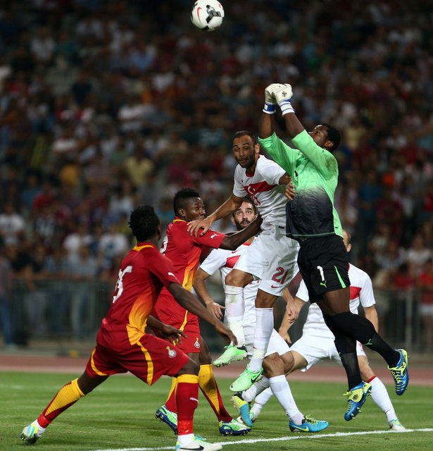 Goalkeeper Razak Brimah comes out to make a save.