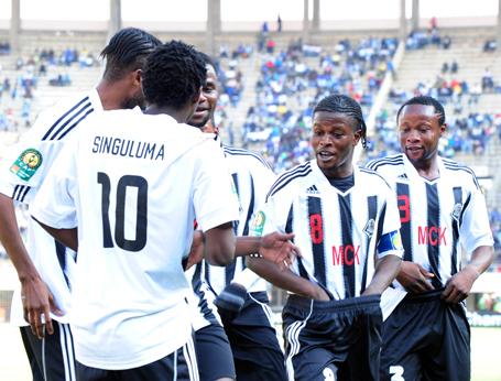 TP Mazembe players celebrating a goal