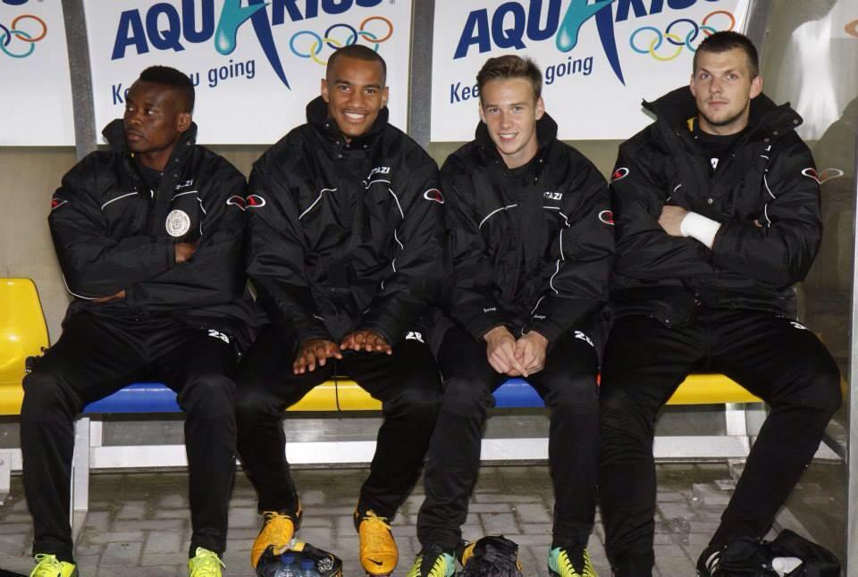 Ansah, first from left, watching from the Lokeren bench as they beat Lierse