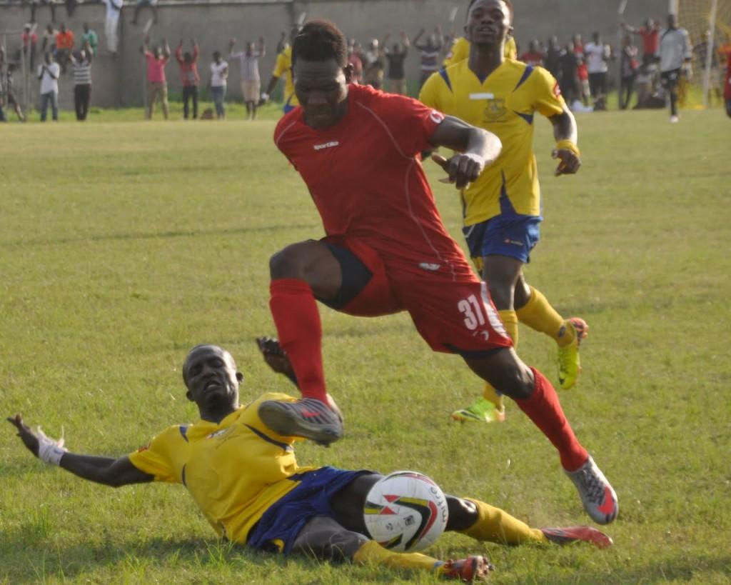 New Edubiase United's Emmanuel Nti Mensah goes in a for tackle against Bernard Cofie