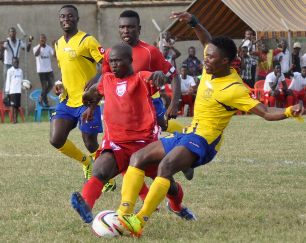 Asiedu Attobrah (yellow jersey) and Joseph Aidoo contests for the ball