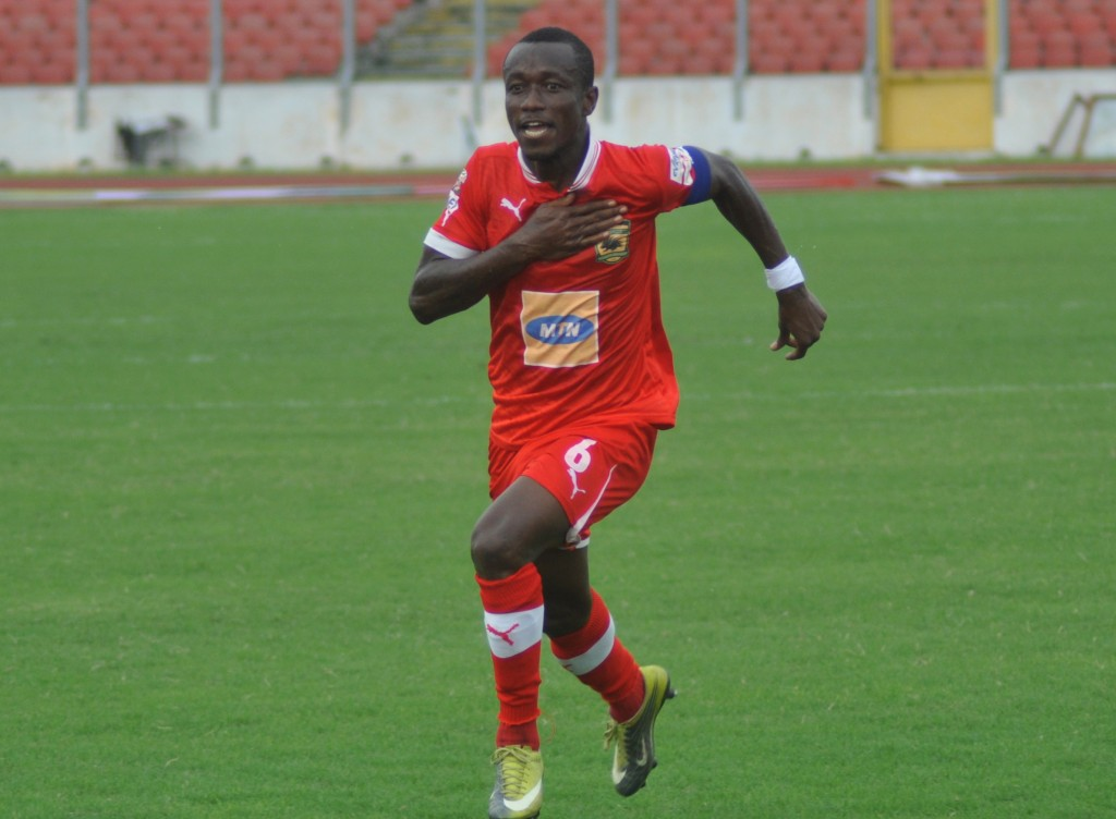 Kotoko midfielder Michael Akuffo celebrating a goal.