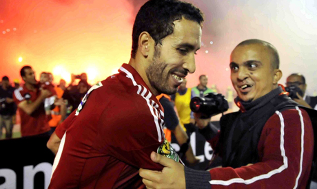Mohamed Abou-Treika is embraced by a fan after winning South Africa's Orlando Pirates (Photo: AP)