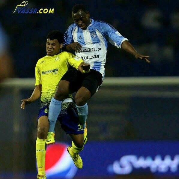 Saddick Adams in an air tussle with Al Nassr players