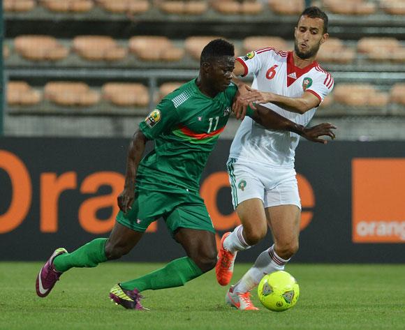 Kudakwashe Mahachi of Zimbabwe is fouled by Eric Traore and Ekisee To of Burkina Faso