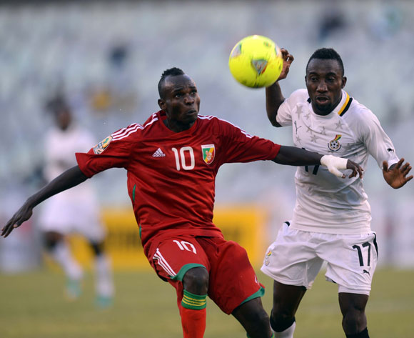 Latif Mohammed of Ghana battles with Moise Nkounkou of Congo during the 2014 CAF African Nations Championships match between Ghana and Congo on the 13 January 2014 at Free State Stadium