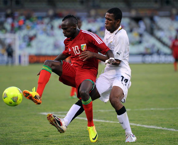 Joshua Tijani of Ghana battles with Moise Nkounkou of Congo during the 2014 CAF African Nations Championships match between Ghana and Congo on the 13 January 2014 at Free State Stadium