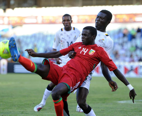 Kwabena Adusei of Ghana battles with Kader Bidimbou of Congo during the 2014 CAF African Nations Championships match between Ghana and Congo on the 13 January 2014 at Free State Stadium