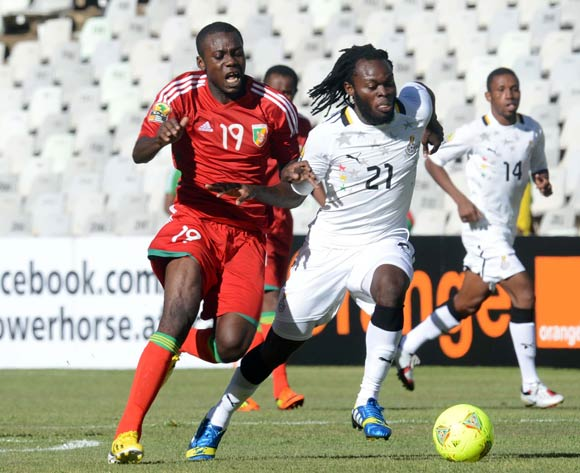 Yahaya Mohammed of Ghana battles with Dua Ankira of Congo during the 2014 CAF African Nations Championships match between Ghana and Congo on the 13 January 2014 at Free State Stadium