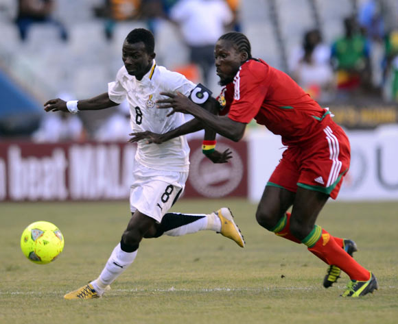 Jordan Opoku of Ghana battles with Davy Magnokele of Congo during the 2014 CAF African Nations Championships match between Ghana and Congo on the 13 January 2014 at Free State Stadium