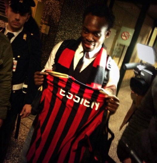 Essien handed Milan jersey on arrival