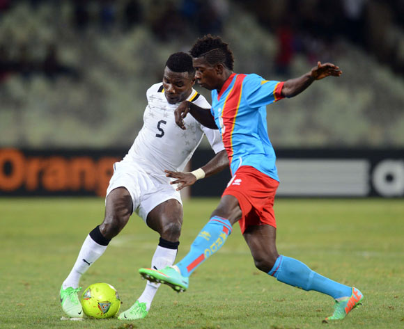 Abeiku Ainooson of Ghana battles with Jean Marc Mundele of DR Congo during the 2014 CAF African Nations Championships QuarterFinal match between Ghana and DR Congo on the 26 January 2014 at Free State Stadium