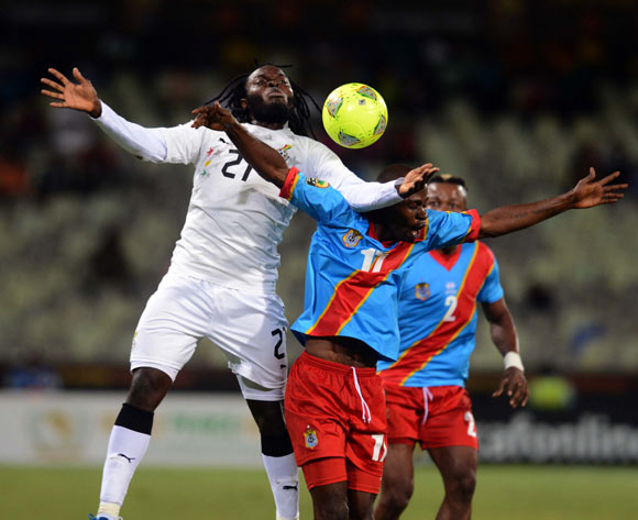 Yahaya Mohammed of Ghana battles with Guy Lusadisu of DR Congo during the 2014 CAF African Nations Championships QuarterFinal match between Ghana and DR Congo on the 26 January 2014 at Free State Stadium