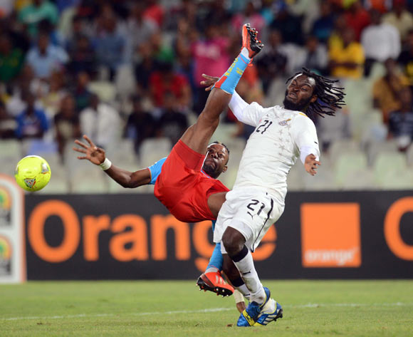Yahaya Mohammed of Ghana battles with Joel Kimuaki of DR Congo during the 2014 CAF African Nations Championships QuarterFinal match between Ghana and DR Congo on the 26 January 2014 at Free State Stadium