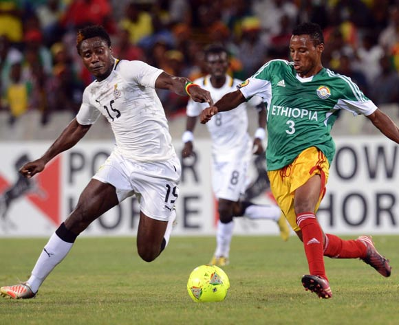 Fasika Gebregiorgis of Ethiopia battles with Nuru Sulley of Ghana during the 2014 CAF African Nations Championships match between Ethiopia and Ghana on the 21 January 2014 at Free State Stadium