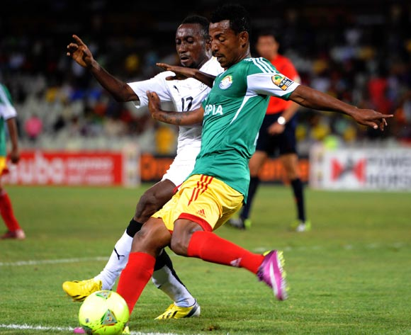 Abebaw Bune of Ethiopia battles with Abdul Mohammed of Ghana during the 2014 CAF African Nations Championships match between Ethiopia and Ghana on the 21 January 2014 at Free State Stadium
