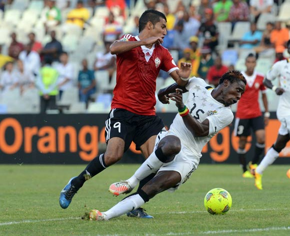 Nuru Sulley of Ghana battles with Mohamed Ghanudi Abushnaf during the 2014 CAF African Nations Championships match between Ghana and Libya on the 17 January 2014 at Free State Stadium
