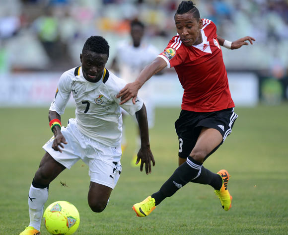 Richard Mpong of Ghana battles with Elmehdi Elhouni of Libya during the 2014 CAF African Nations Championships match between Ghana and Libya on the 17 January 2014 at Free State Stadium