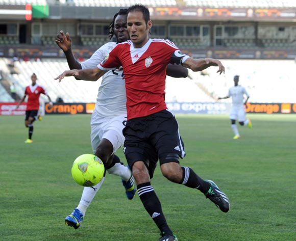 Yahaya Mohammed of Ghana battles with Ali Salama of Libya during the 2014 CAF African Nations Championships match between Ghana and Libya on the 17 January 2014 at Free State Stadium