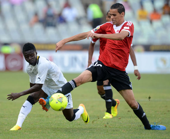 Richard Mpong of Ghana battles with Faisal Ali of Libya during the 2014 CAF African Nations Championships match between Ghana and Libya on the 17 January 2014 at Free State Stadium