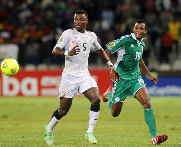 Samuel Ainooson of Ghana challenged by Abdullahi Shehu of Nigeria during the 2014 CAF African Nations Championships football match between Ghana and Nigeria at Free State Stadium in Free State, on the 29 January 2014