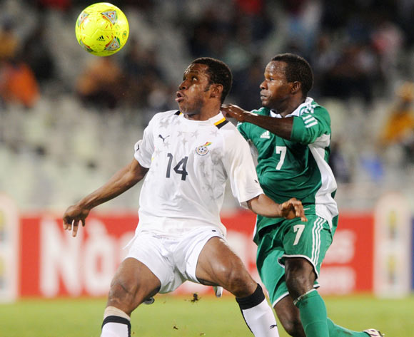 Joshua Tijani of Ghana battles with Christantus Ejike of Nigeria during the 2014 CAF African Nations Championships football match between Ghana and Nigeria at Free State Stadium in Free State, on the 29 January 2014