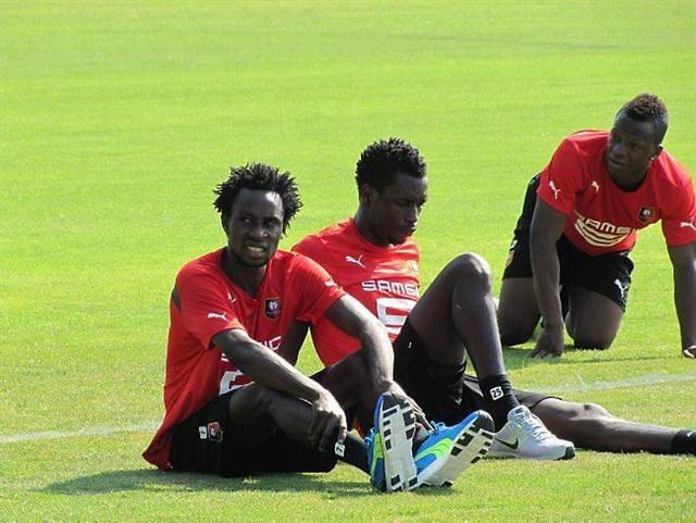 Ghana defender with Burkinabe attack Jonathan Pitriopa at Rennes training