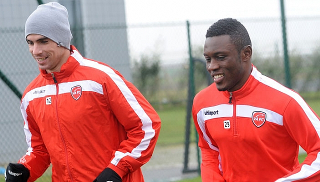 Ghana's Abdul Majeed Waris,left, training with Algerian Carl Medjani, will mark his debut in the French Ligue 1 on Saturday