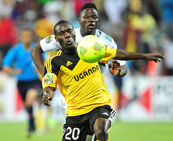 Isaac Muleme of Uganda gets to the ball ahead of Bassirou Ouedraogo of Burkina Faso.
