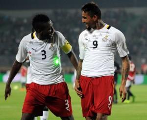 Asamoah Gyan celebrating with Kevin-Prince Boateng