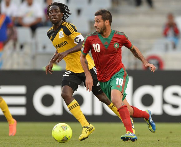 Mohsine Moutaouali of Morocco gets away from Denis Iguma of Uganda