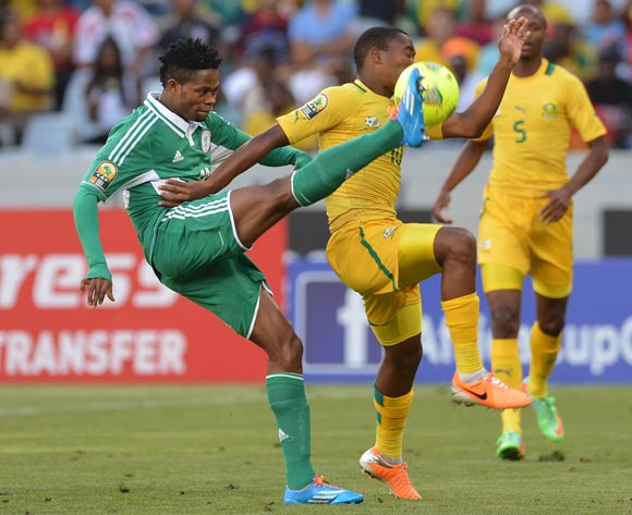 Sibusiso Vilakazi of South Africa battles for the ball with Bright Eseme of Nigeria during the 2014 CAF African Nations Championships Group A football match between Nigeria and South Africa at Cape Town Stadium, Cape Town on 19 January 2014