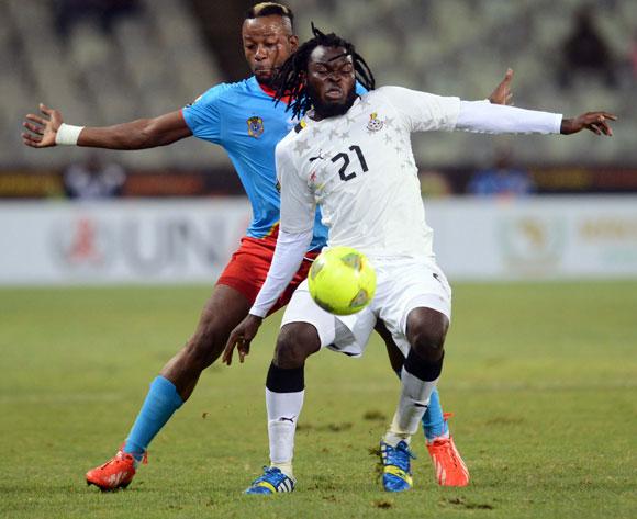 Yahaya Mohammed of Ghana battles with Joel Kimuaki of DR Congo