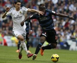 Mohammed Fatau shrugs off a challenge from Angel Di Maria.