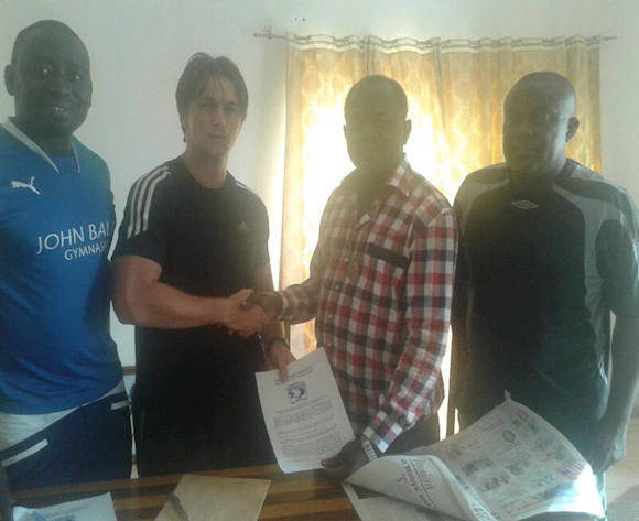 Tom Strand (second left) shaking hands with Bechem president Kingsley Owusu Achiaw.