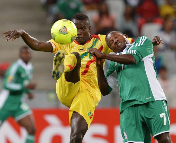 Ejike Uzoenyi battles for the ball against Mali at the CHAN