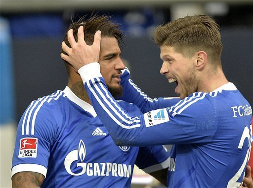 Kevin-Prince Boateng celebrating with Huntelaar.