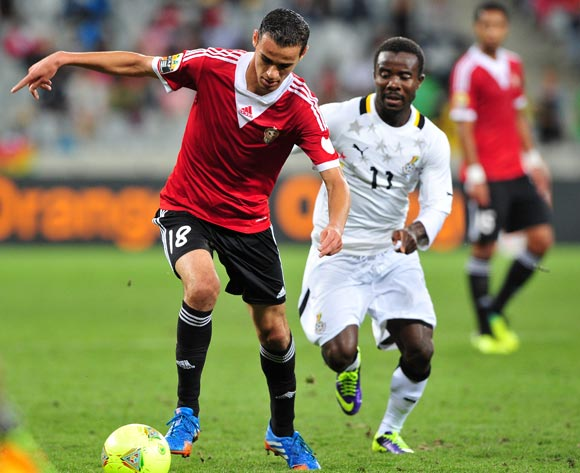 Faisal Ali of Libya takes on Theophilus Anobaah of Ghana during the 2014 CAF African Nations Championships Final between Libya and Ghana at Cape Town Stadium, Cape Town on 1 February 2014