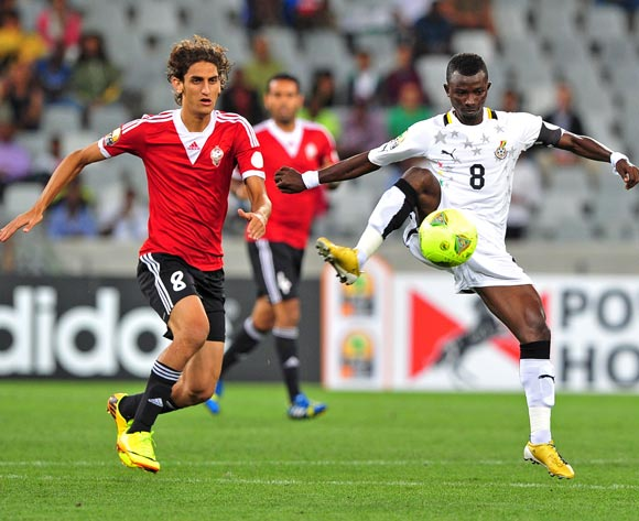 Jordan Opoku of Ghana gets to the ball ahead of Mohamed Elgadi of Libya during the 2014 CAF African Nations Championships Final between Libya and Ghana at Cape Town Stadium, Cape Town on 1 February 2014