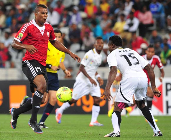 Elmutasem Abushnaf of Libya runs at Nuru Sulley of Ghana during the 2014 CAF African Nations Championships Final between Libya and Ghana at Cape Town Stadium, Cape Town on 1 February 2014